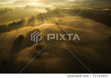 Aerial view of early morning european countryside with fog. 71329407