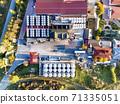 Asconi winery with industrial metallic barrels 71335051