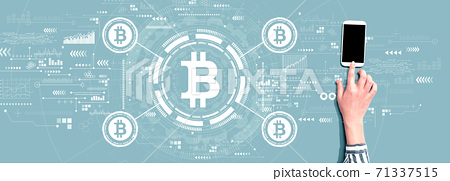 Bitcoin theme with person using smartphone 71337515