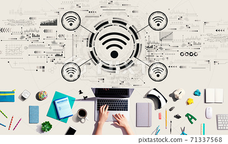 Wifi theme with person using a laptop 71337568