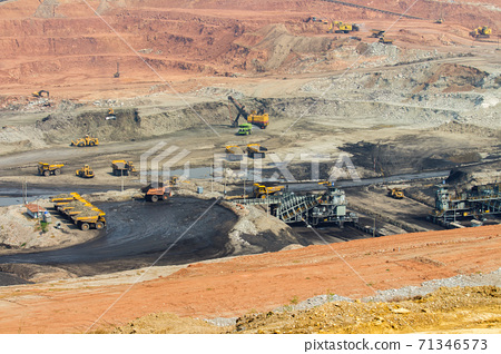 Part of a pit with big mining truck working 71346573