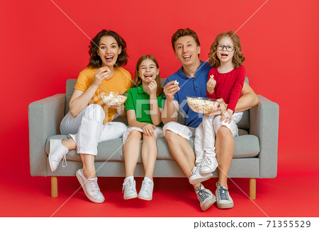 Happy loving family on bright color background. 71355529