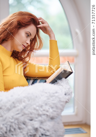 readhead student woman learning and reading books at home 71357726