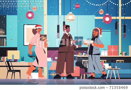 colleagues in santa hats holding gifts mix race coworkers celebrating new year and christmas holidays 71358469