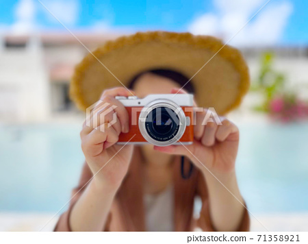 A woman taking a photo at a resort 71358921