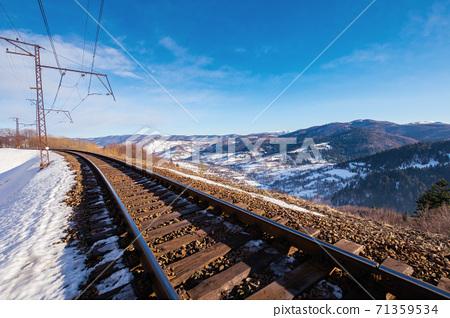 railroad in mountains. frosty winter landscape. transportation scenery 71359534