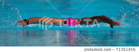 Swim competition swimmer athlete doing butterfly stroke in swimming pool 71361856