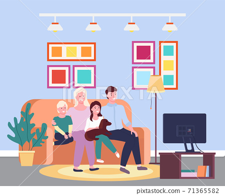 Family evening at the tv. Four member family smiling sitting io the sofa in front of the televisor 71365582