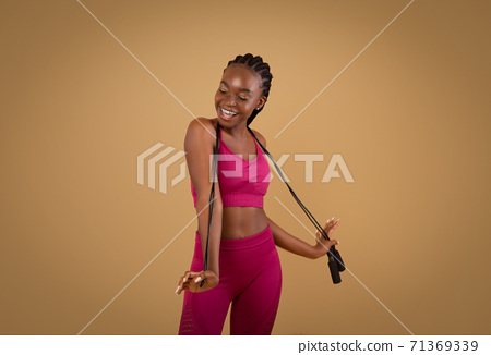 Fitness Concept. Portrait Of Joyful Fit Black Lady Posing With Jump Rope 71369339