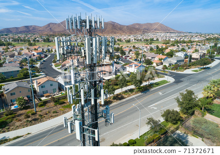 Close-up Aerial of Cellular Wireless Mobile Data Tower with Neighborhood Surrounding 71372671