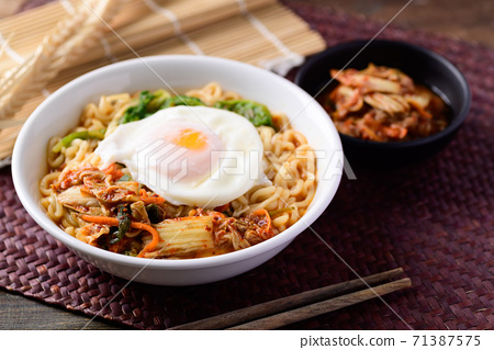 Korean food, Spicy noodles soup with kimchi and egg 71387575