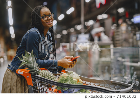 Woman shopping vegetables at the supermarket 71401032