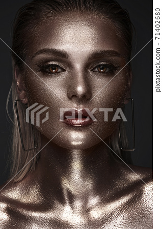 Portrait of beautiful woman with art space makeup on her face and body. Glitter Face. 71402680