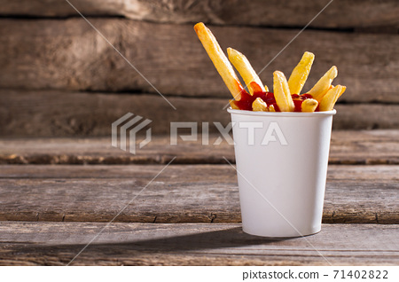 Fries with sauce in cup. 71402822