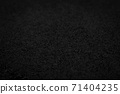Abstract black background with sandpaper texture 71404235