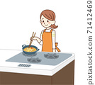 Housewife making fried food 71412469