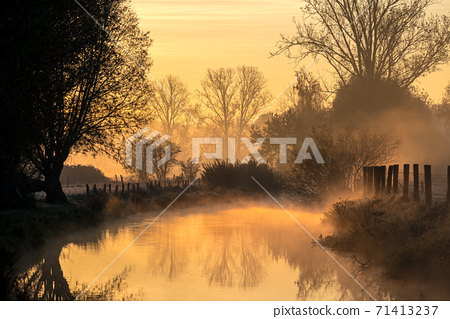 fog floating over the water 71413237