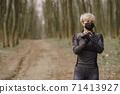 Masked woman training during coronavirus 71413927