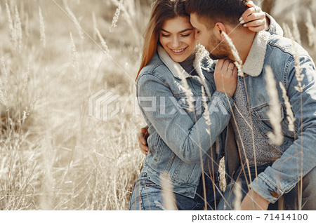 Cute couple in a jeans clothes in a spring field 71414100