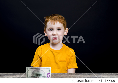 boy with five us dollars, cash 71415580