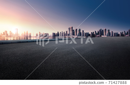 Panoramic skyline and buildings with empty space dark Paved road.  71427888