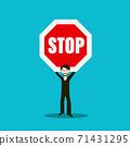 Man Holding Stop Sign 71431295