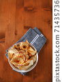 Dried apple chips 71435736