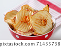 Dried apple chips 71435738