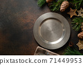 Christmas table setting with empty plate. 71449953