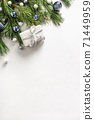Christmas gift, fir branches on white. 71449959