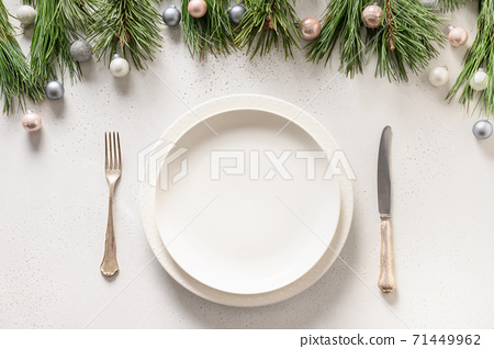 Christmas table setting with holiday decorations 71449962