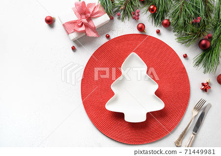 Christmas table setting with holiday decorations 71449981