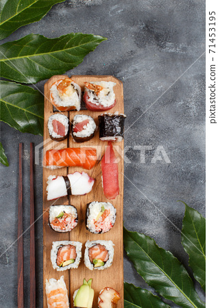 Sushi Set nigiri and sushi rolls on a wooden tray 71453195