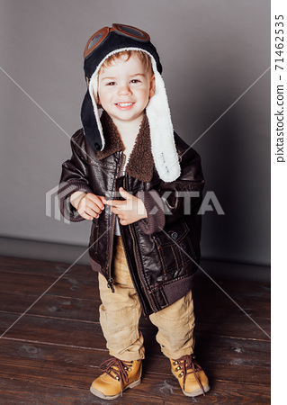 Portrait of a beautiful little boy in a plane pilot costume 71462535