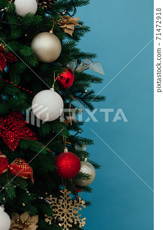 Christmas tree decorated with blue new year's toys 71472918