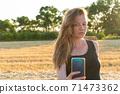 Woman in black long dress looking making selfie 71473362