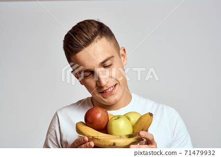 Man with fresh fruit in a cup health lifestyle healthy nutrition vitamins 71479932