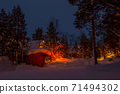 Evening in the Winter Woods, House, and Garland on the Tree 71494302