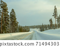 Empty Winter Highway Through Wooded Hills 71494303