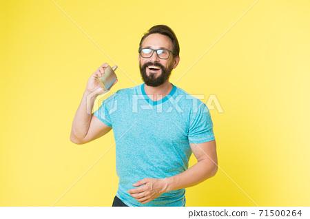 Amazing benefits of using perfumes. Man bearded handsome hold bottle  71500264
