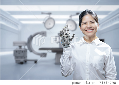 woman with metal prosthetic hand 71514298