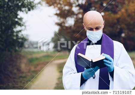 Prayer of a priest in a small village during a pandemic. 71519107