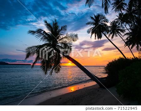 Sunset dramatic sky on sea, tropical desert beach, no people, stormy clouds, travel destination, Indonesia Banyak Islands Sumatra 71522945