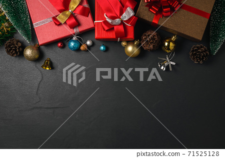 Christmas decorations and gift box on dark table. Top view with copy space 71525128