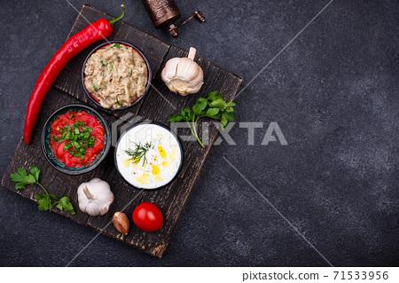 Baba ganoush, tzatziki and tomato ezme 71533956
