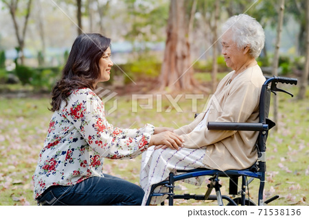 Holding touching hands Asian senior or elderly old lady woman patient with love 71538136