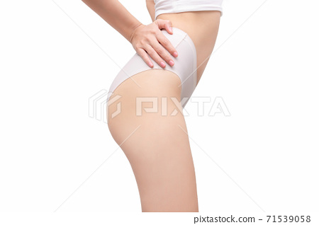 Perfect slim toned young body of the girl. Fitness or plastic surgery and aesthetic cosmetology isolated on white background. 71539058