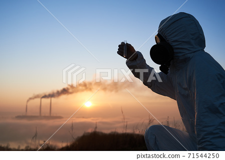Scientist holding test tube at thermal power plant. 71544250