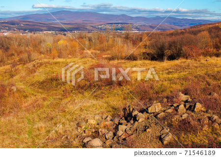 rural valley in the morning. beautiful autumn scenery in mountains. town in the distant valley. clouds on the blue forenoon sky 71546189