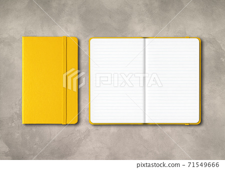 Yellow closed and open lined notebooks on concrete background 71549666